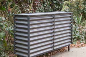 Corrugated metal insert planter for a restaurant/sportsbar in Denver